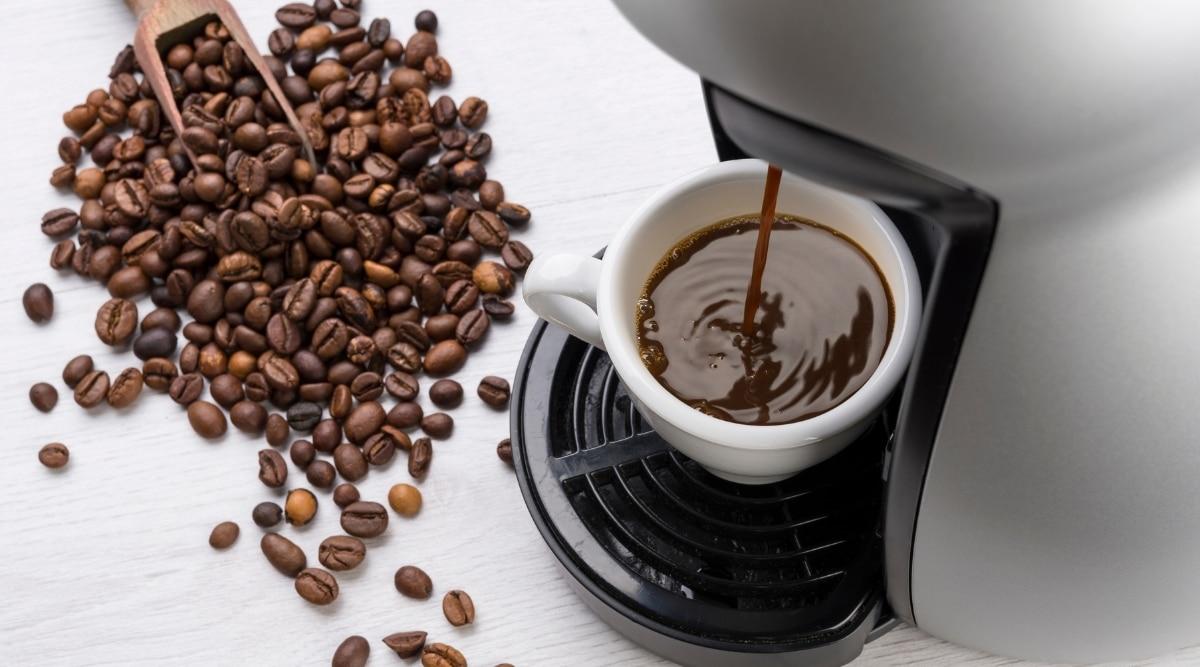 Keurig machine brewing coffee.
