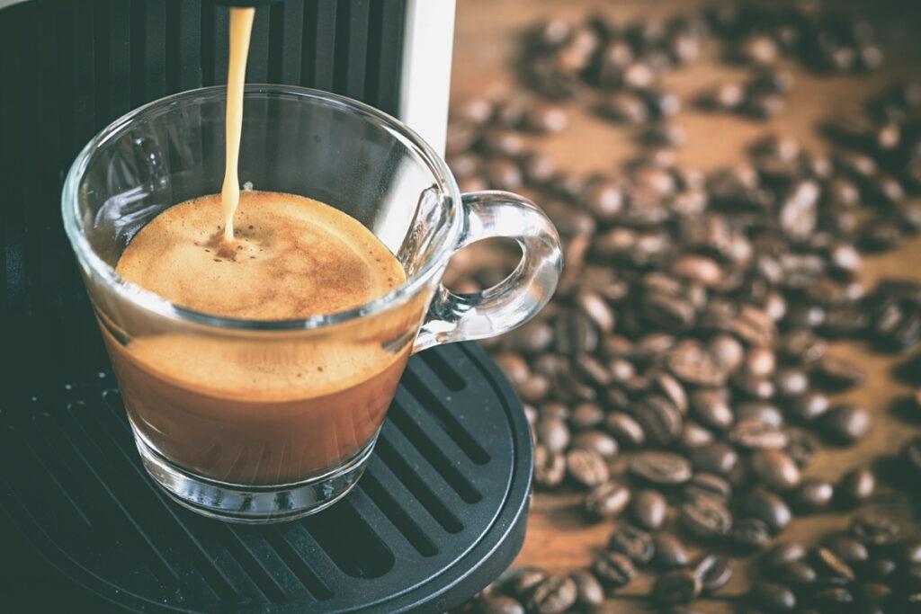 Espresso being brewed by a Nespresso machine.