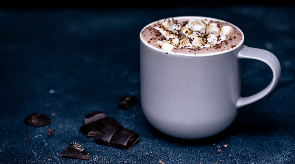 Cup of Hot cocoa with marshmallows and chocolate crumbs.