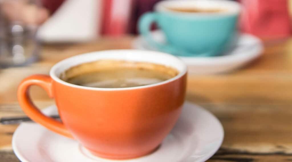 Two cups of coffee to represent the Keurig K50 model vs Keurig K55 model.