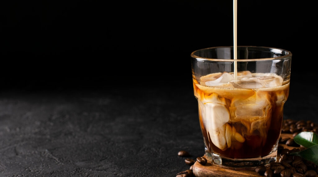 Iced cold brew coffee poured into a glass cup.