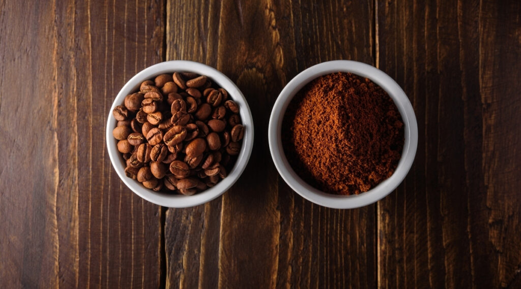 Bowl of coffee beans and ground coffee.