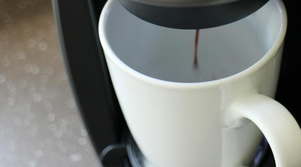 Keurig K Elite or K Elite C brewing coffee in a cup.