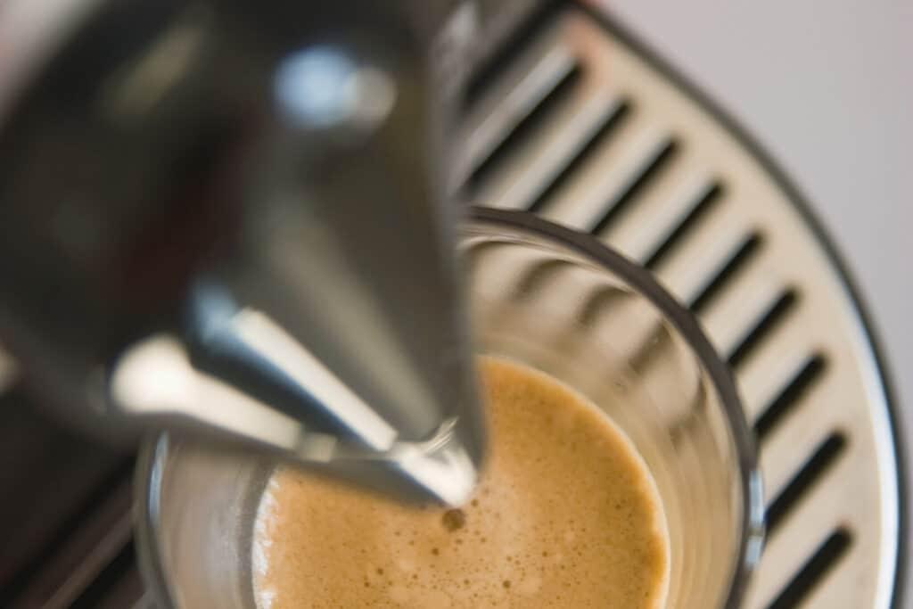 Nespresso machine brewing espresso.