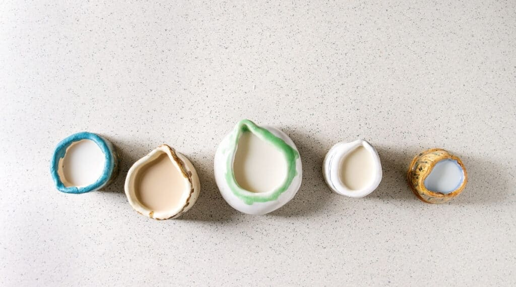 A variety of non dairy coffee creamers side by side.