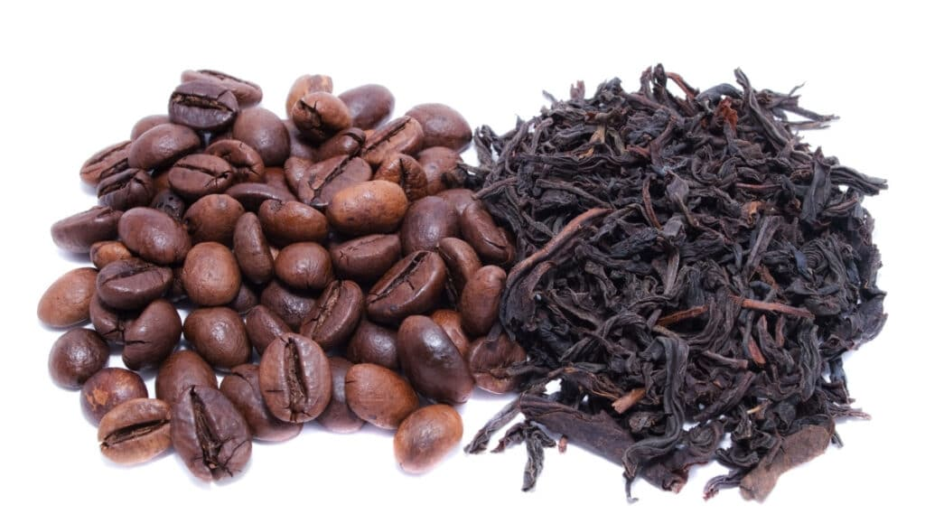 coffee beans and tea leaves side by side.