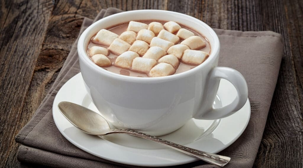 A cup of hot cocoa made by Keurig K-Cup.