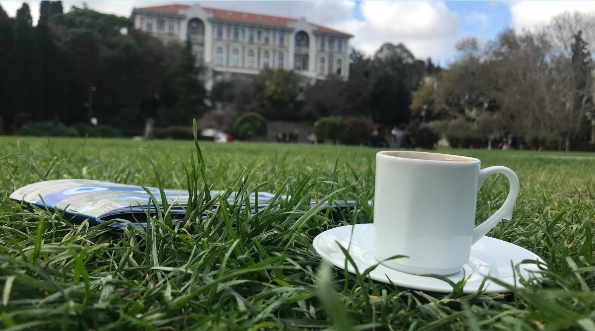 Cup of coffee on college campus.