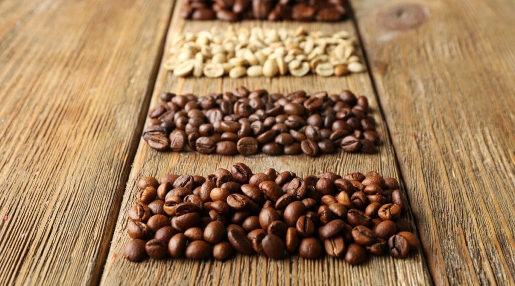 Different types of coffee beans ready for selection.