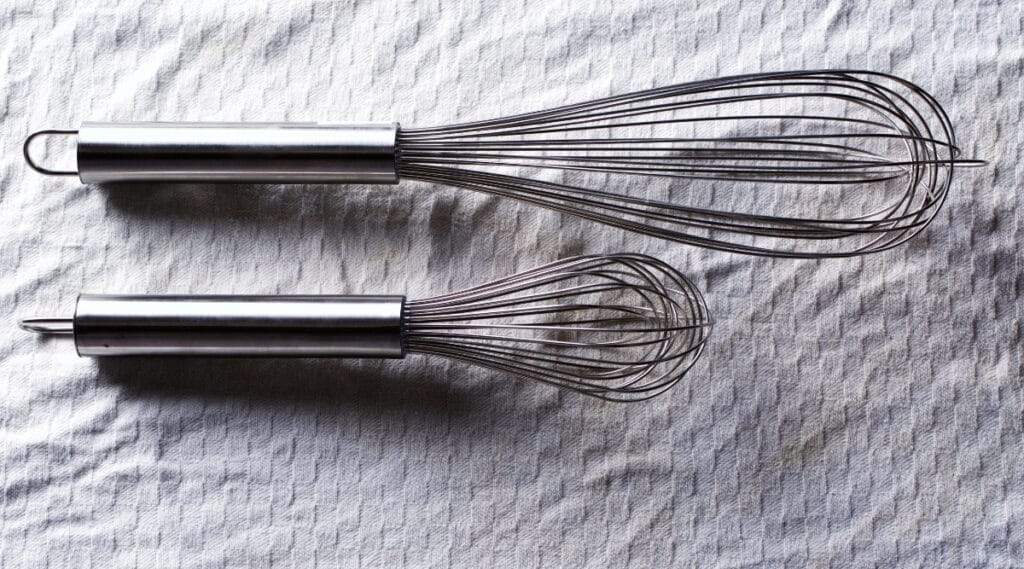 Aluminum whisks used to make a latte.