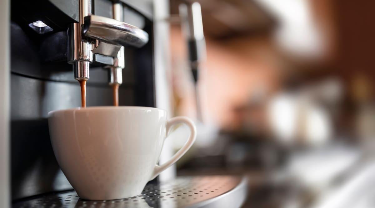Nespresso machine making a cup of espresso.