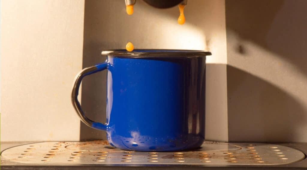 Nespresso's Pixie brewing espresso.