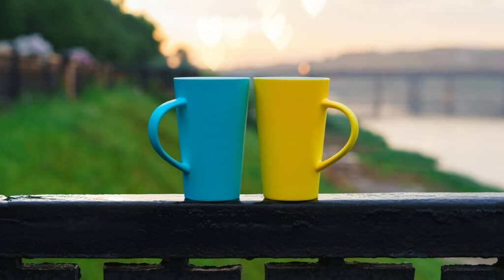 Two coffee cups representing Nespresso and Keurig.
