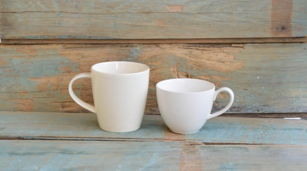 Two different coffee cups representing a Keurig and drip coffee maker.