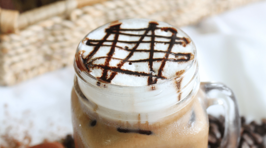 Chocolate syrup adds a sweet topping to the Mocha Iced Doppio.